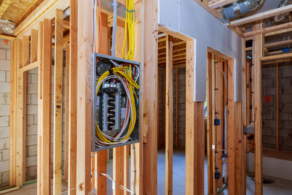 Interior wood framing of house under construction electrician power supply for the house